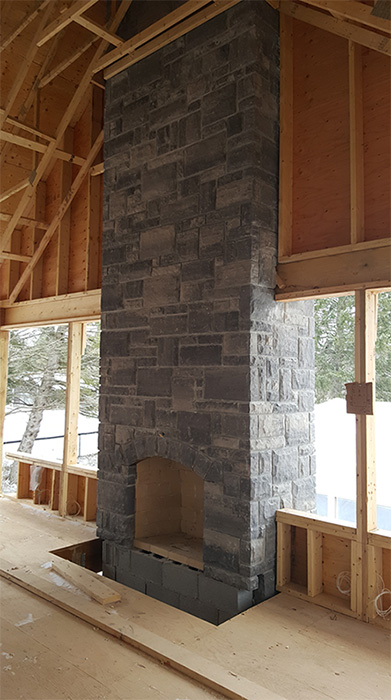 Brampton brick vivace stone fireplace completed by Amplify Masonry