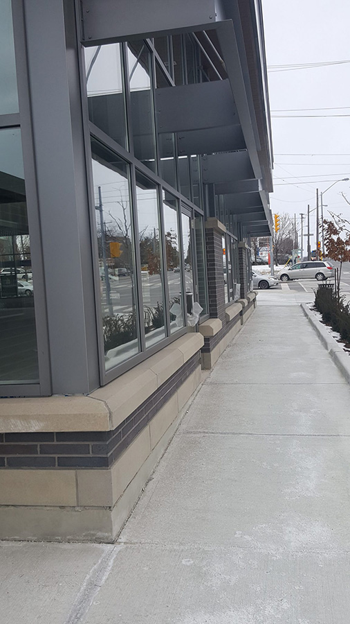 Commercial masonry metric black brick product on a Starbucks completed by Amplify Masonry