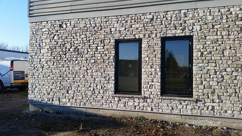 A commercila masonry building with stone veneer completed by Amplify Masonry