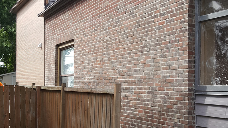 Masonry restoration done on a red brick wall by Amplify Masonry
