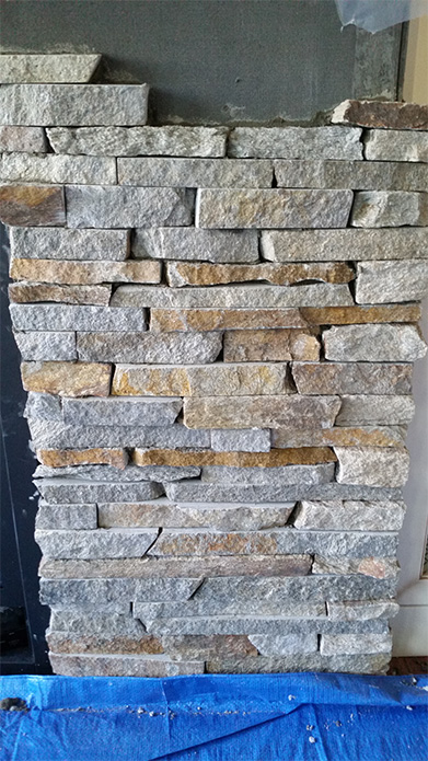 Natural thin stone veener stone fireplace completed by Amplify Masonry