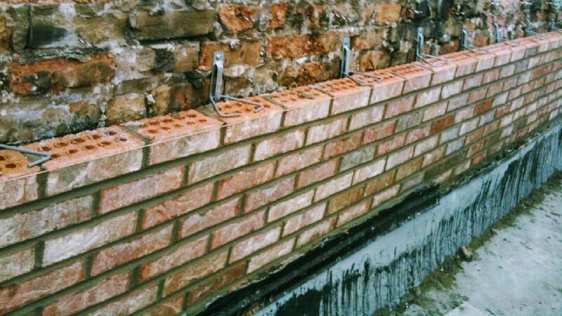Brick repair being done on a old wall in Toronto by Amplify Masonry