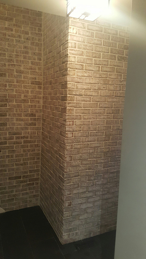 indoor white sliced brick venner installed by Amplify Masonry