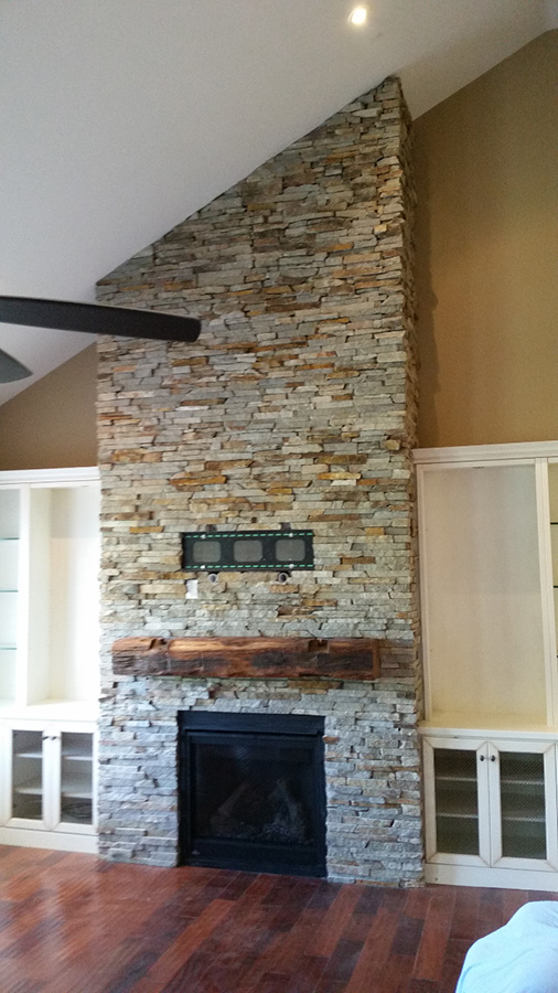 Natural Thin stone brick veneer fireplace completed by Amplify Masonry