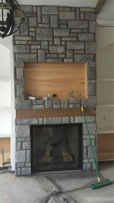 vivace stone veneer stone fireplace completed by Amplify Masonry